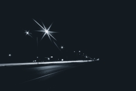Highway in the city at night with streetlights and long exposure