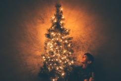 Boy next to a tree